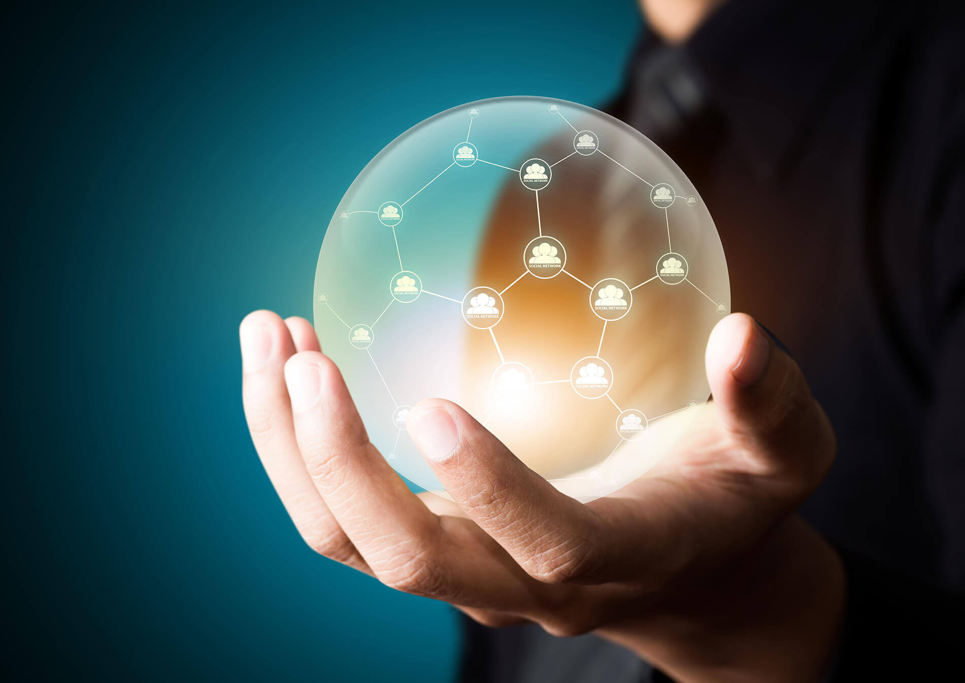 a hand holding a crystal ball of connected data